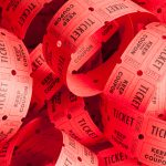 Unwound Messy Roll of Red Tickets Piled Up illustrating the Selling Ticketed Events Online blog post